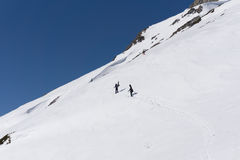 Snowboarders walking uphill for freeride. Extreme sport Stock Images