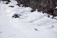 Snowboarders walking uphill for freeride. Extreme sport Stock Photography