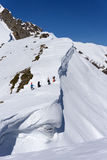 Snowboarders walking uphill for freeride Stock Photos