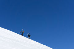 Snowboarders walking uphill for freeride. Extreme sport Royalty Free Stock Photography