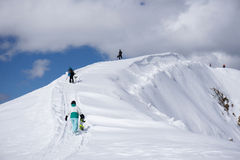 Snowboarders walking uphill for freeride. Extreme sport Stock Photos