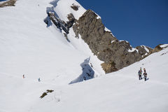 Snowboarders walking uphill for freeride Stock Photo