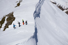 Snowboarders walking uphill for freeride, extreme sport Royalty Free Stock Images