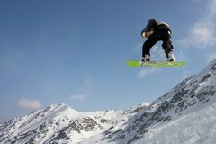 Snowboarding. Trick in the mountains Stock Photos