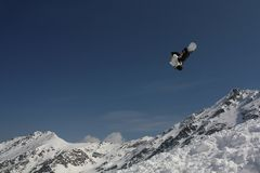 Snowboarding. Trick in the mountains Stock Photography