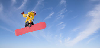 Snowboarding. Trick jumping on the snowboard Stock Photos