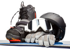 Snowboarding. Snowboard with boot helmet gloves and goggles on white background Royalty Free Stock Photography