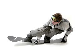 Snowboarding. Cool snowboarder flexing the board, isolated Royalty Free Stock Image