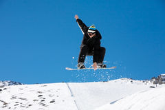Snowboarding action Stock Image