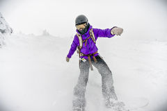 Snowboarding in Alpine Winter Royalty Free Stock Photography