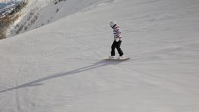 Snowboarder follow shot