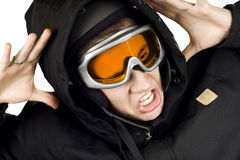 Snowboarding boy shocked. Boy dressed in snowboarding suit and helmet and googles reacting surprised on something he sees Royalty Free Stock Photography