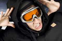 Snowboarding boy shocked. Boy dressed in snowboarding suit and helmet and googles reacting surprised on something he sees Royalty Free Stock Images