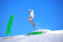 Snowboarding competition. A snowboarder jumping in a competition Stock Image