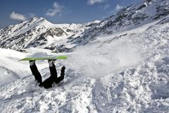 Snowboarding crash. Extreme crashes while snowboarding in the Fagaras mountains royalty free stock images