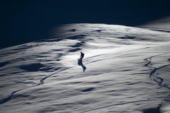Snowboarding de fin de l'après-midi Photographie stock libre de droits
