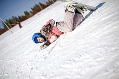 Snowboarding fall broken. Close up of the snowboarder falling down on the slope Stock Photography