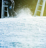 Snowboarding fast with snow trail sunny flare Royalty Free Stock Image