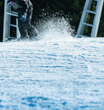 Snowboarding fast with snow trail Royalty Free Stock Images