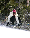 Snowboarding in a forest. Snowboarder jumping high at Lake Tahoe resort Royalty Free Stock Image