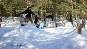 Snowboarding in forestry mountain. In sunny weather stock video