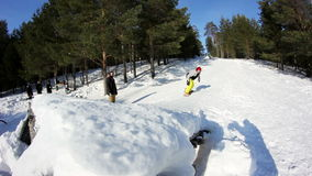 Snowboarding in forestry mountain. In sunny weather. Trying to backflip stock video