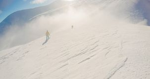 Snowboarding freeride winter, along man with board in mountains. Snowboarding freeride winter along man with board in mountains before ride on the top Royalty Free Stock Photography