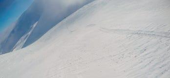 Snowboarding freeride winter, first pervon view in mountains. Snowboarding freeride winter first pervon view in mountains before ride on the top Stock Photo
