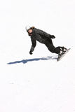 A snowboarding girl in black Stock Photo