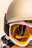 Snowboarding Helmet and Goggles. Detail of ski goggles with helmet Stock Photography