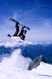 Snowboarding jump Stock Images