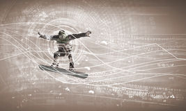 Snowboarding. Male snowboarder making jump against media background Stock Image