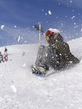 Snowboarding on the mountain. A snowboarder going down the mountain Stock Photography