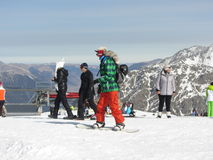 Snowboarding in the mountains of Dombay. Snowboarder ski Dombai, Northern Caucasus Royalty Free Stock Photo