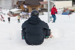 Snowboarding with mountains, rear view. Winter sports Royalty Free Stock Photography