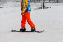 Snowboarding with mountains. Rear view, winter sports Stock Images