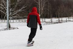 Snowboarding with mountains. Rear view, winter sports Stock Photos