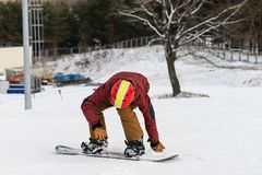Snowboarding with mountains. Rear view, winter sports Stock Photo