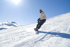 Snowboarding na foto do estoque do sol Foto de Stock Royalty Free