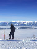 Snowboarding over the clouds Royalty Free Stock Photography