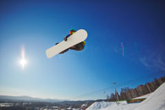 Snowboarding over snowdrift Royalty Free Stock Image