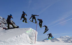 Snowboarding Park fun kickers Royalty Free Stock Photography