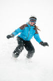 Snowboarding in snow storm. Beautiful young girl  on snowboard Stock Photo