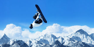 Snowboarding. Snowboarder making jump high in clear sky Stock Photo