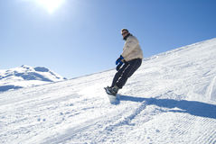 Snowboarding in the sun stock photo Royalty Free Stock Photo