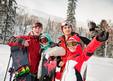 snowboarding team in winter mountains stock photo