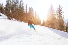 Snowboarding in winter Alps, man with fast speed on snowboard stock photography