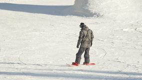Snowboarding in the winter park stock footage