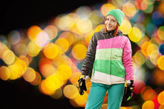 Snowboarding woman with christmas lights Stock Images