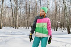 Snowboarding woman in forest Stock Photos